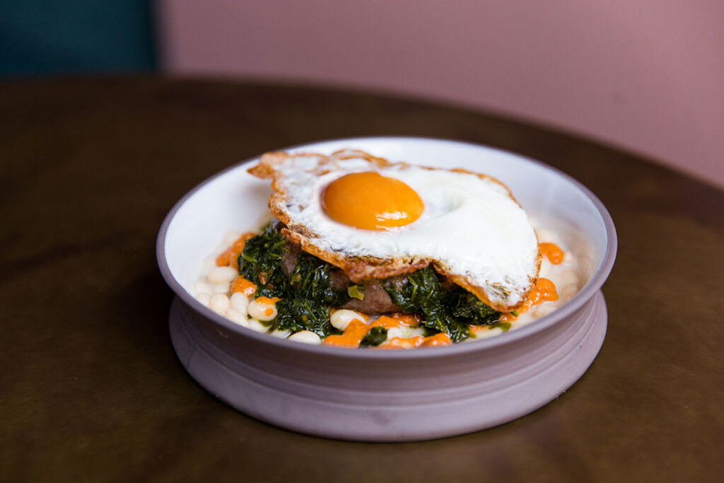 A main dish topped with an egg